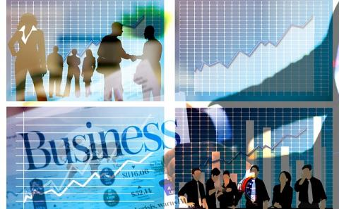 Four quadrants with business elements such as people together and a chart showing growth