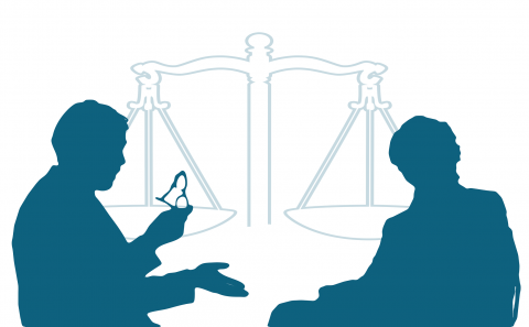 Two silhouettes in front of a legal balance having a discussion