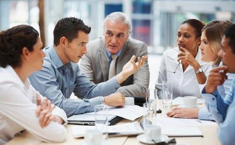 Diverse group negotiating at a business meeting
