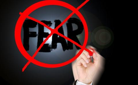 The word fear with a red cross and circle crossing out the word.