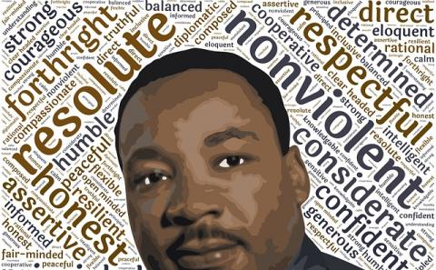 Rev. Dr. Martin Luther King portrait with key words behind such as nonviolent
