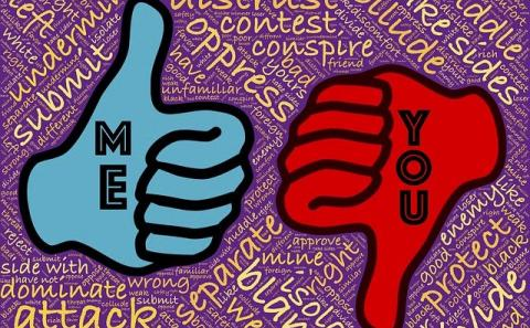 """A blue thumbs up """"me"""" and red thumbs down """"them"""""""