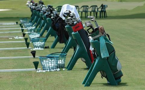 golf clubs set up at the practice range