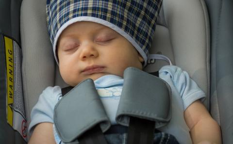 Baby sleeping soundly in a car seat