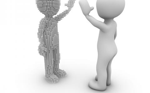 A figure waving hi to another pixel figure