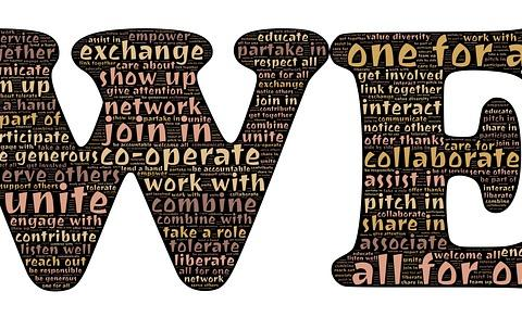 The word we with a host of smaller words like unite and join in written within the we.