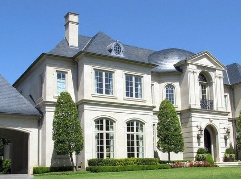 A mansion with many rooms and a big garage