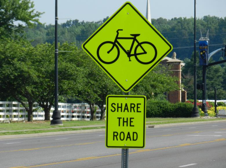 Share the road sign with a bicycle above it
