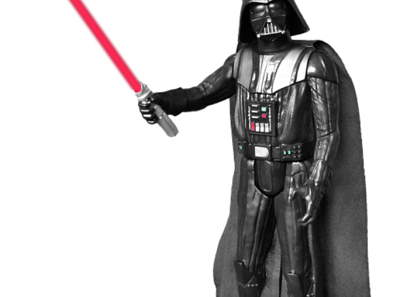 Darth Vader with a lightsaber ready to strike