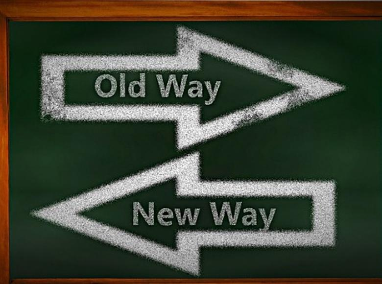 Two horizontal arrow pointing opposite ways with old way and new way