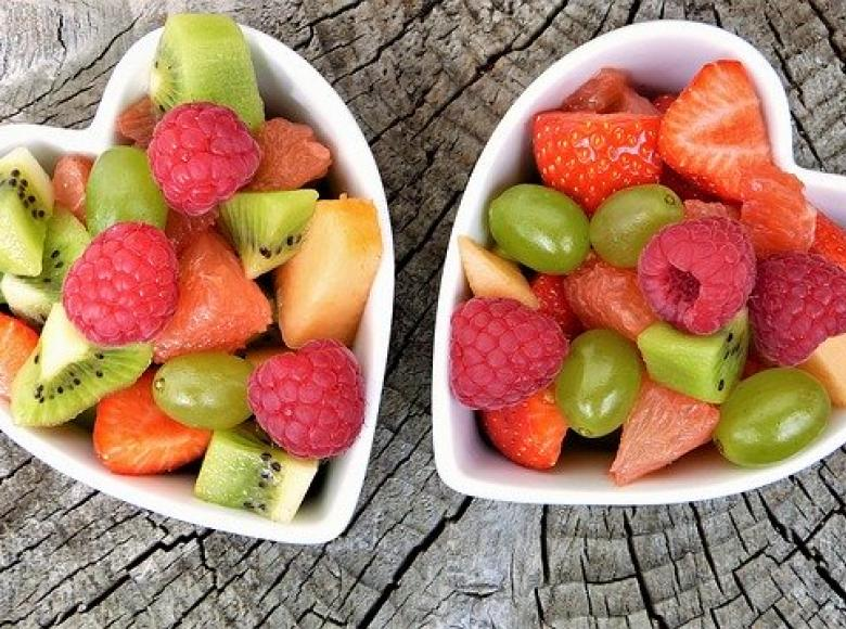 Two bowels of fruit in heart shaped containers