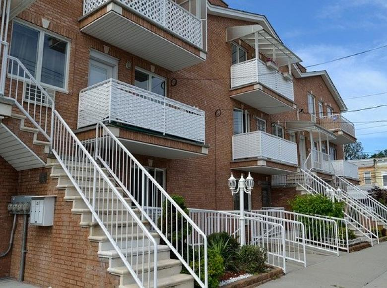 2 story apartment building with balconies